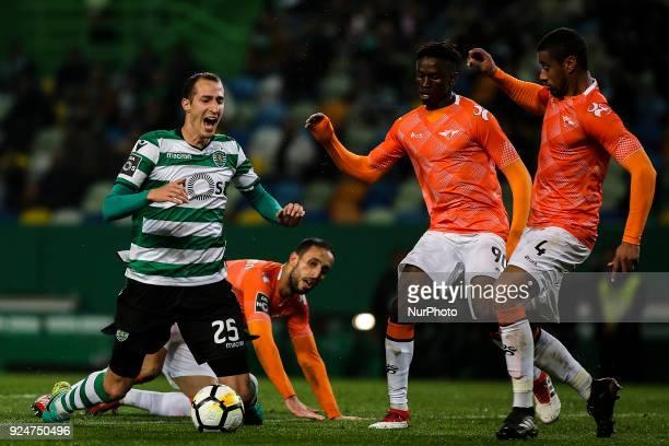 Sporting's midfielder Radoslav Petrovic vies with Moreirense's midfielder Alfa Semedo and Moreirense's defender Iago Santos during the Portuguese...