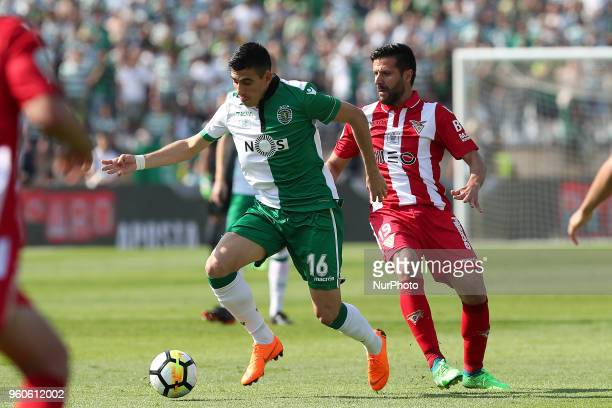 Sporting's midfielder Rodrigo Battaglia from Argentina vies with Aves' midfielder Braga during the Portugal Cup Final football match CD Aves vs...