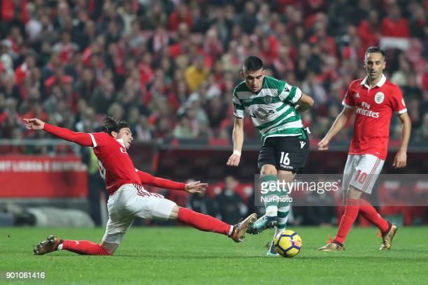 Sporting's midfielder Rodrigo Battaglia from Argentina vies with Benfica's Croatian forward Filip Krovinovic during the Portuguese League football...