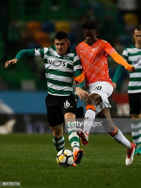 Sporting's midfielder Rodrigo Battaglia vies for the ball with Moreirense's midfielder Alfa Semedo during Primeira Liga 2017/18 match between...