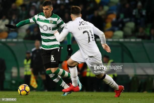 Sporting's midfielder Rodrigo Battaglia vies with Guimaraes's midfielder Fabio Sturgeon during the Portuguese League football match between Sporting...