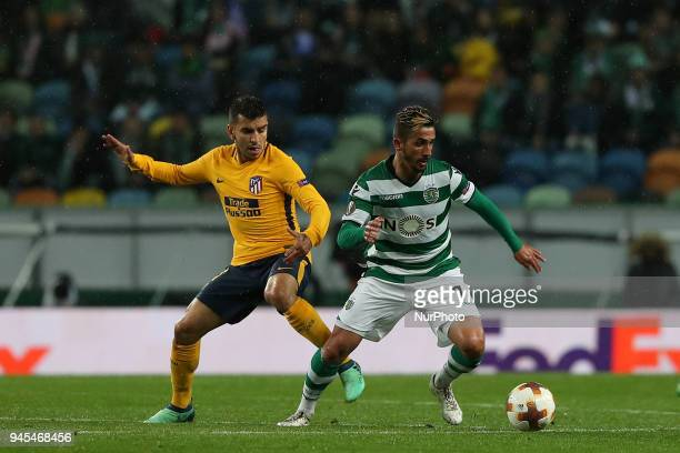 Sporting's midfielder Ruben Ribeiro from Portugal vies with Atletico Madrids forward Angel Correa of Argentina during the UEFA Europa League second...