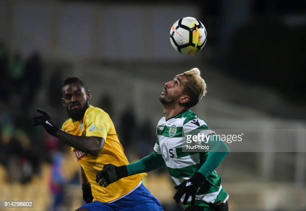 Sporting's midfielder Ruben Ribeiro vies with Estoril's defender Dankler during the Portuguese League football match between Estoril Praia and...