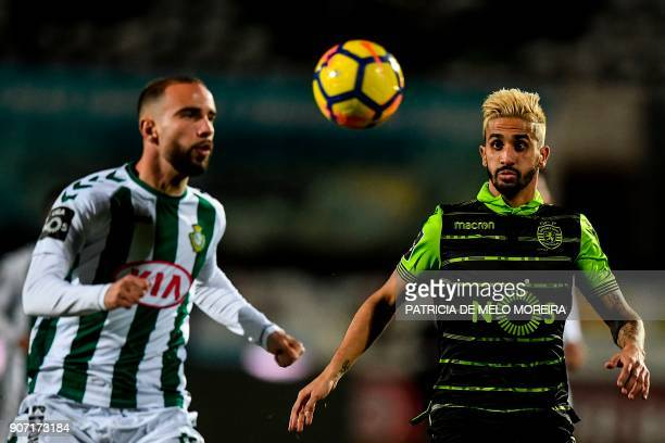 Sporting's midfielder Ruben Ribeiro vies with Vitoria Setubal's defender Pedro Pinto during the Portuguese league football match between Vitoria FC...