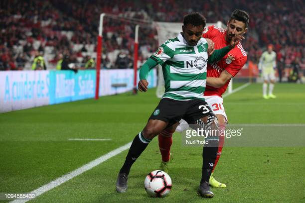 Sporting's midfielder Wendel from Brazil vies with Benfica's Portuguese defender Andre Almeida during the Portugal Cup Semifinal first leg football...