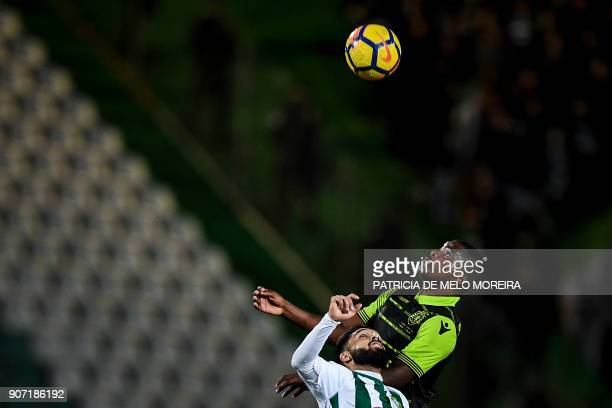 Sporting's midfielder William de Carvalho heads the ball with Vitoria Setubal's midfielder Joao Costinha during the Portuguese league football match...