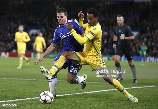 Sporting's Peruvian forward Andre Carillo challenges Chelsea's Spanish defender Cesar Azpilicueta during the UEFA Champions League group G football...