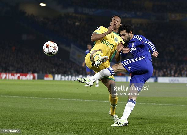 Sporting's Peruvian forward Andre Carillo vies for the ball with Chelsea's Egyptian midfielder Mohamed Salah during the UEFA Champions League group G...