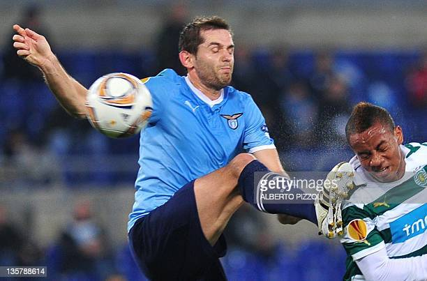 Sporting's Peruvian forward Andre Carillo vies with Lazio's Bosnian forward Senad Lilic during the UEFA Europa league Group D football match between...