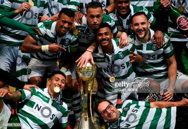 Sporting's players celebrate with the trophy after winning the Portuguese Taca da Liga or League Cup final football match against Porto at the Braga...