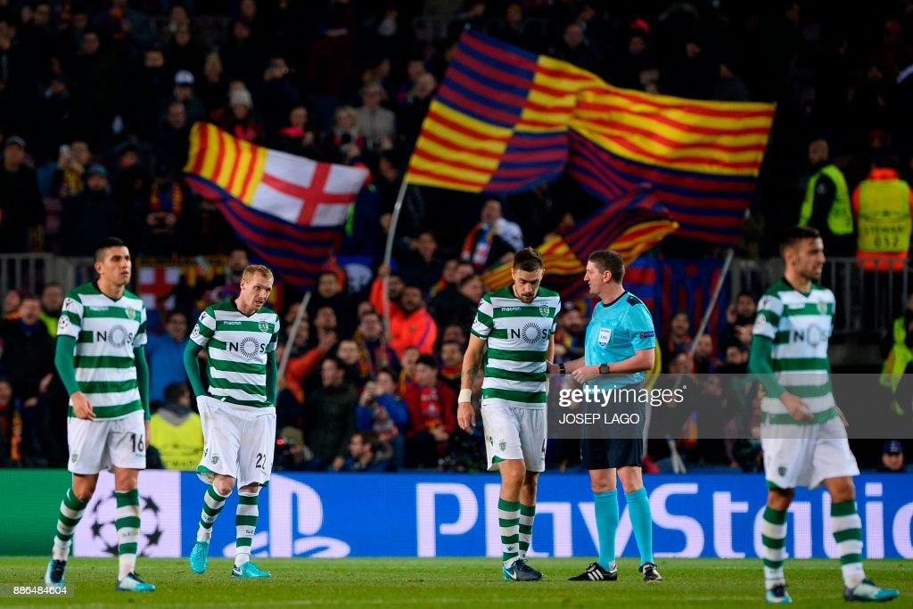 Sporting's players react at the end of the UEFA Champions League football match FC Barcelona vs Sporting CP at the Camp Nou stadium in Barcelona on December 5, 2017. / AFP PHOTO / Josep LAGO