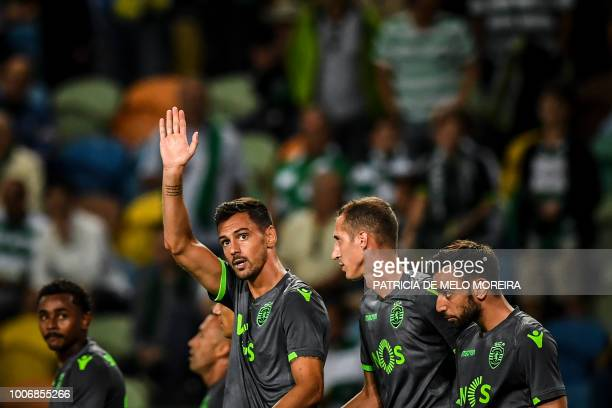 Sporting's Portuguese defender Andre Pinto celebrates with teammates after scoring a goal during a friendly football match between Sporting and...