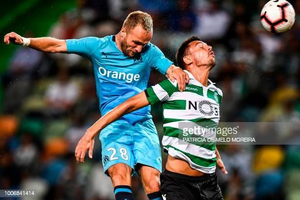 Sporting's Portuguese defender Andre Pinto heads the ball with Marseille's French forward Valere Germain during a friendly football match between...