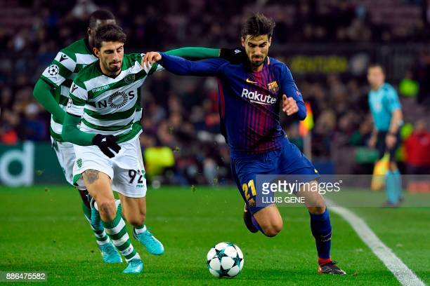 Sporting's Portuguese defender Cristiano Piccini challenges Barcelona's Portuguese midfielder Andre Gomes during the UEFA Champions League football...