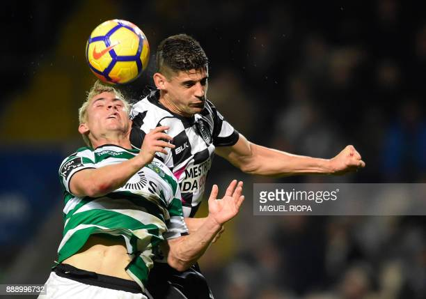 Sporting's Portuguese forward Daniel Podence vies with Boavista's Italian defender Raphael Rossi during the Portuguese league football match between...
