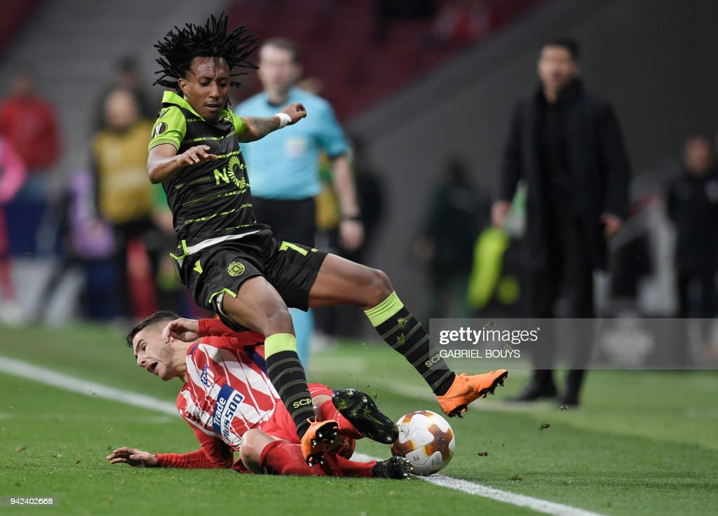 Sporting's Portuguese forward Gelson Martins (top) vies with Atletico Madrid's French defender Lucas Hernandez during the UEFA Europa League quarter-final first leg football match between Club Atletico de Madrid and Sporting CP at the Wanda Metropolitano Stadium in Madrid on April 5, 2018. /