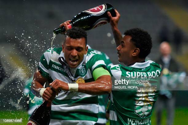 Sporting's Portuguese forward Nani celebrates with Sporting's Brazilian midfielder Wendel after winning the Portuguese Taca da Liga or League Cup...