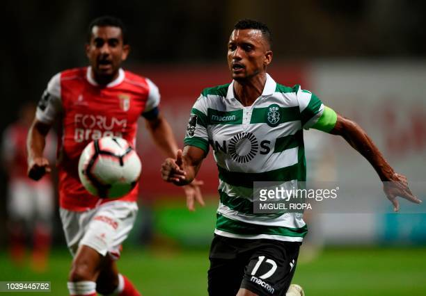 Sporting's Portuguese forward Nani vies with Sporting Braga's Brazilian defender Marcelo Goiano during the Portuguese league football match between...
