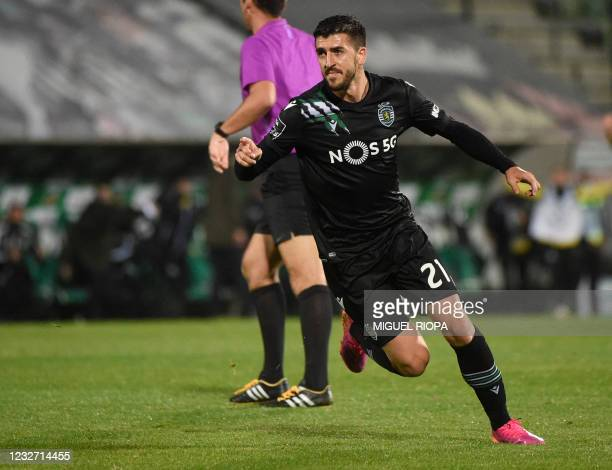 Sporting´s Portuguese forward Paulinho celebrates after scoring a goal during the Portuguese League football match between Rio Ave FC and Sporting...