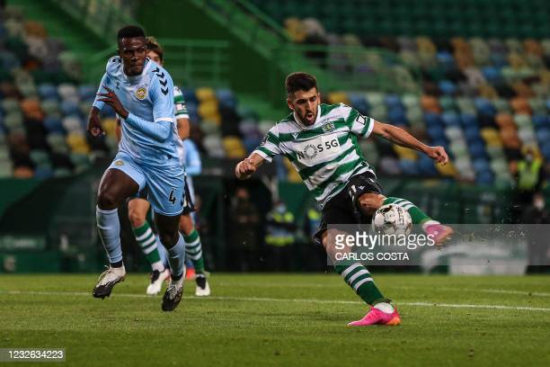 Sporting's Portuguese forward Paulinho vies with Nacional's Brazilian defender Pedrao during the Portuguese League football match between Sporting...