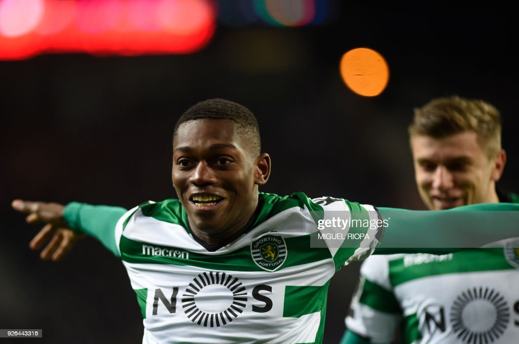 Sporting's Portuguese forward Rafael Leao (L) celebrates a goal during the Portuguese league football match FC Porto against Sporting CP at the Dragao stadium in Porto on March 02, 2018. /