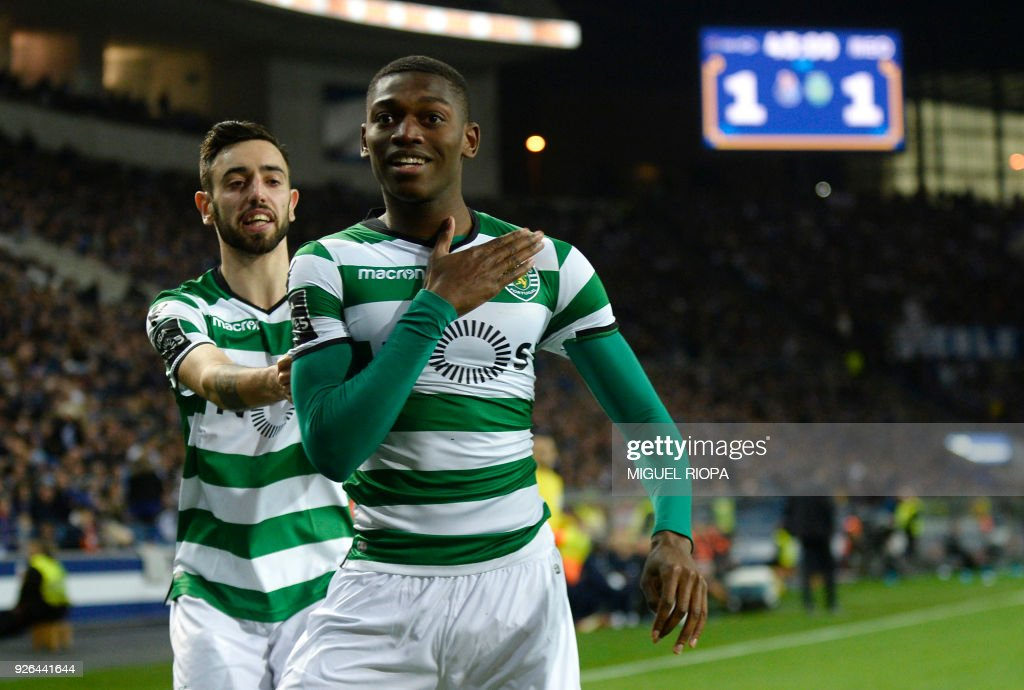 Sporting's Portuguese forward Rafael Leao (R) celebrates a goal with teammate Portuguese midfielder Bruno Fernandes during the Portuguese league football match FC Porto against Sporting CP at the Dragao stadium in Porto on March 02, 2018. /