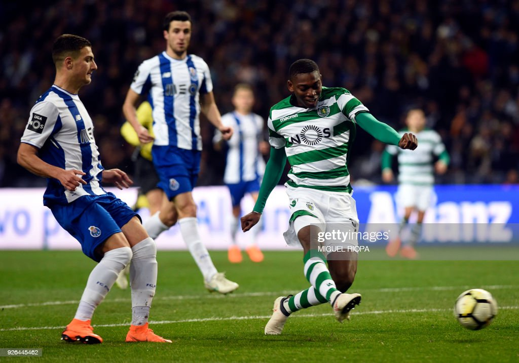 Sporting's Portuguese forward Rafael Leao (R) shoots to score a goal during the Portuguese league football match FC Porto against Sporting CP at the Dragao stadium in Porto on March 02, 2018. /