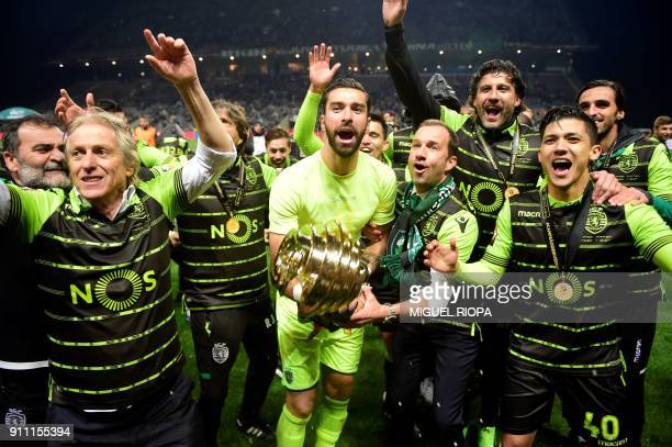 Sporting's Portuguese goalkeeper Rui Patricio celebrates with teammates after winning the Portuguese Cup final football match between Vitoria FC and...