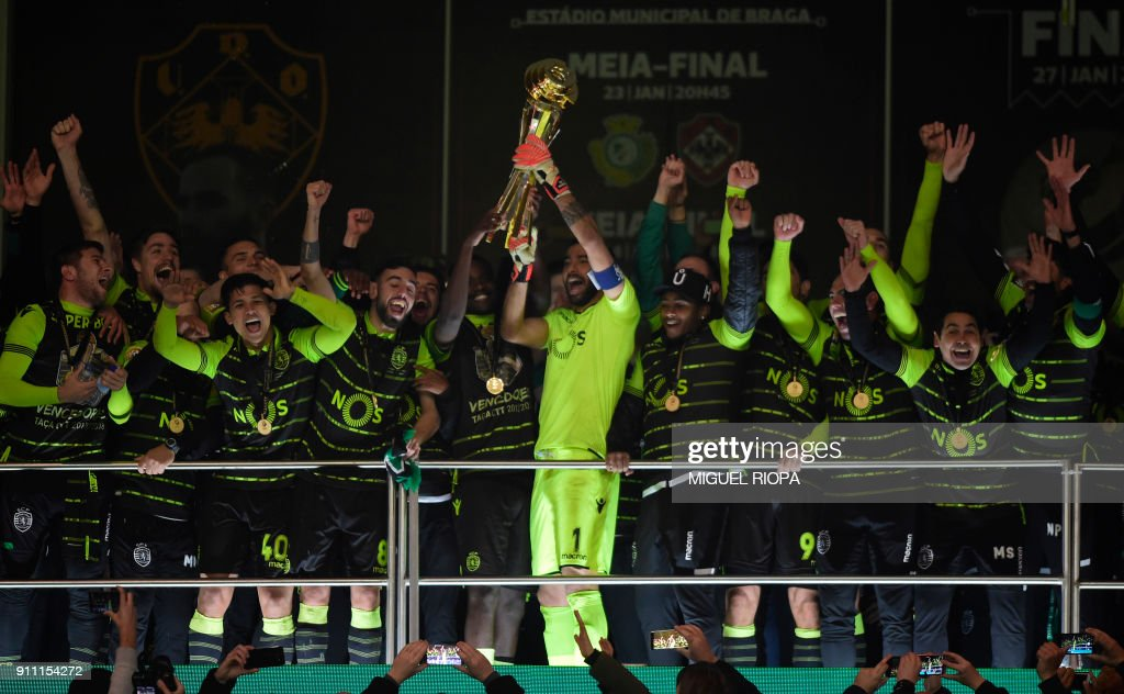 Sporting's Portuguese goalkeeper Rui Patricio (C) holds the trophy as he celebrates with teammates after winning the Portuguese Cup final football match between Vitoria FC and Sporting CP at the Municipal stadium of Braga on January 27, 2018. /