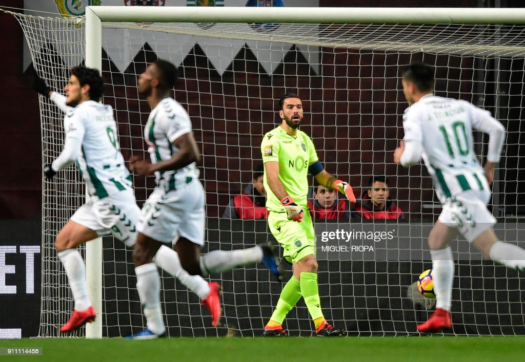 Sporting's Portuguese goalkeeper Rui Patricio (C) reacts after Vitoria FC's Portuguese forward Goncalo Paciencia (L) scored a goal during the Portuguese Cup final match between Vitoria FC and Sporting CP at the Municipal stadium of Braga on January 27, 2018. /