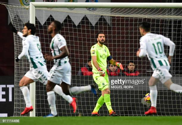 Sporting's Portuguese goalkeeper Rui Patricio reacts after Vitoria FC's Portuguese forward Goncalo Paciencia scored a goal during the Portuguese Cup...