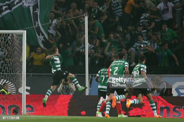 Sporting's Portuguese midfielder Adrien Silva celebrates after scoring a goal during the Portuguese League football match Sporting CP vs SL Benfica...