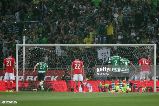 Sporting's Portuguese midfielder Adrien Silva shoots to score a penaty during the Portuguese League football match Sporting CP vs SL Benfica at the...