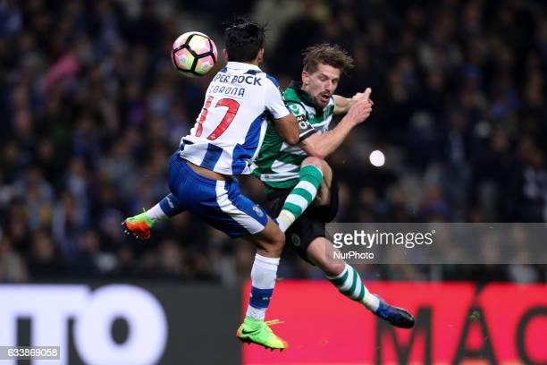 Sporting's Portuguese midfielder Adrien Silva vies with Porto's Mexican forward Jesus Corona during the Premier League 2016/17 match between FC Porto...