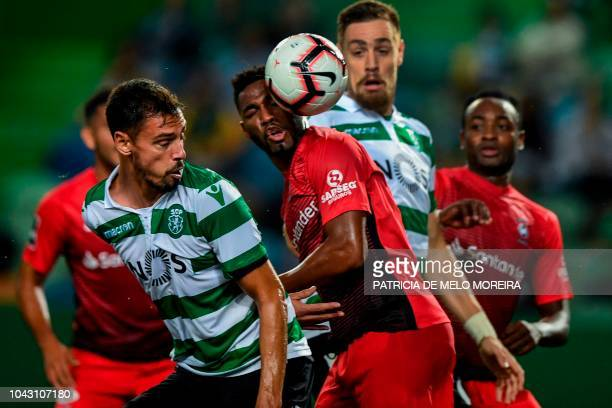 Sporting's Portuguese midfielder Andre Pinto and Maritimo's Brazilian midfielder Jean Cleber head the ball during the Portuguese league footbal match...