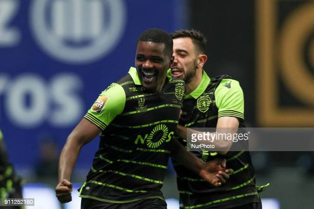 Sporting's Portuguese midfielder Bruno Fernandes and Sporting's Portuguese midfielder William Carvalho celebrates the victory in the game during the...