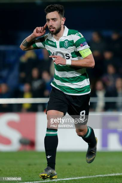 Sporting's Portuguese midfielder Bruno Fernandes celebrates after scoring during the UEFA Europa League round of 32 second leg football match between...
