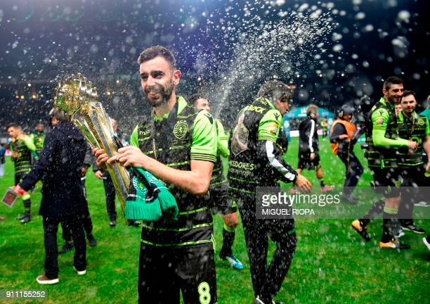 Sporting's Portuguese midfielder Bruno Fernandes celebrates after winning the Portuguese Cup final football match between Vitoria FC and Sporting CP...