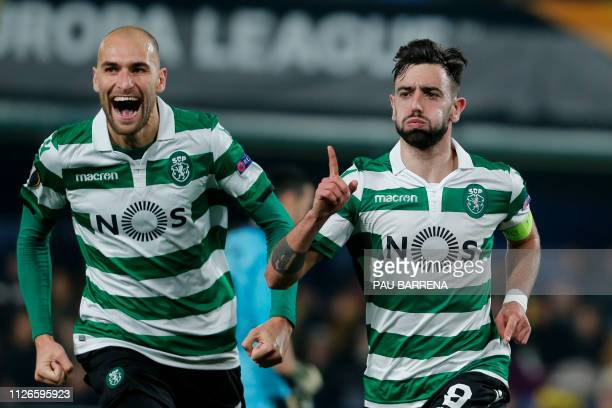 Sporting's Portuguese midfielder Bruno Fernandes celebrates with Sporting's Dutch forward Bas Dost after scoring during the UEFA Europa League round...