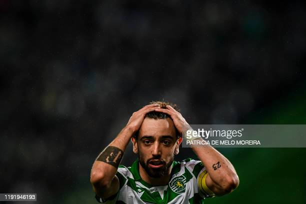 Sporting's Portuguese midfielder Bruno Fernandes reacts touching his head after missing a goal opportunity during the Portuguese league football...