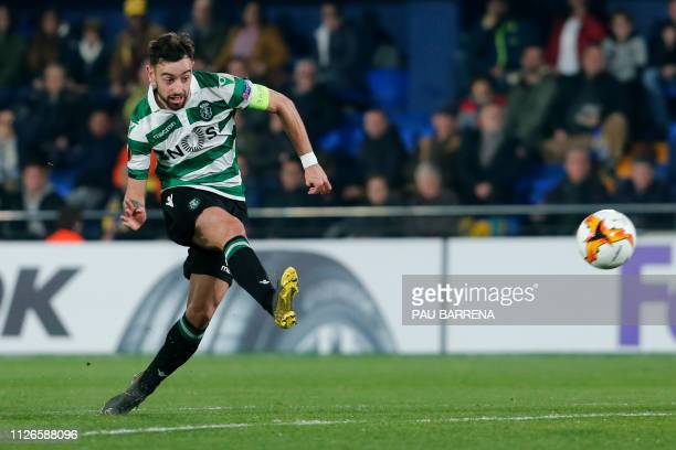 TOPSHOT Sporting's Portuguese midfielder Bruno Fernandes scores during the UEFA Europa League round of 32 second leg football match between...