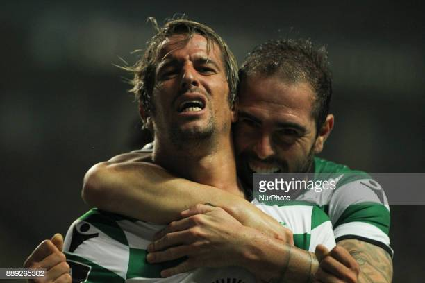 Sporting's Portuguese midfielder Fabio Coentrao celebrates after scoring goal with teammate Sporting's Brazilian midfielder Bruno Cesar during the...