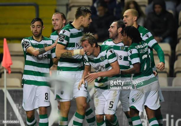 Sporting's Portuguese midfielder Fabio Coentrao celebrates with teammates after scoring a goal during the Portuguese league football match between...