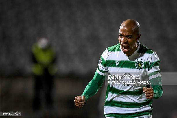Sporting's Portuguese midfielder Joao Mario celebrates his goal during the Portuguese league football match between Belenenses SAD and Sporting CP at...