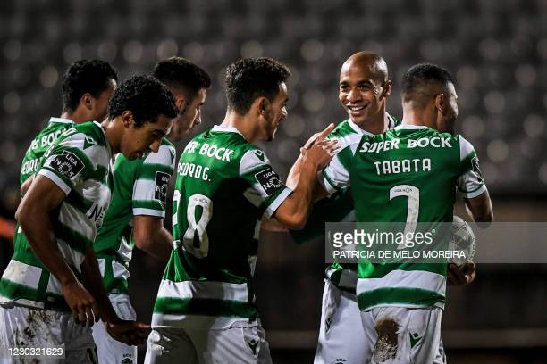 Sporting's Portuguese midfielder Joao Mario celebrates his goal with teammates during the Portuguese league football match between Belenenses SAD and...