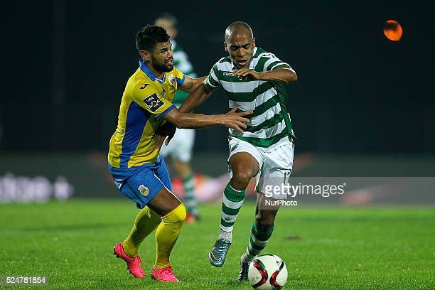 Sporting's Portuguese midfielder Jo��o M��rio vies with Arouca's midfielder Lucas Lima during the Premier League 2015/16 match between FC Arouca and...
