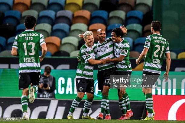 Sporting's Portuguese midfielder Pedro Goncalves celebrates his goal with teammates during the Portuguese League football match between Sporting CP...