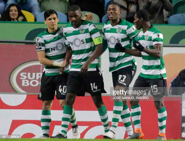 Sportings Portuguese midfielder William Carvalho celebrates his goal with teammates Colombian forward Fredy Montero and Portuguese midfielder and...