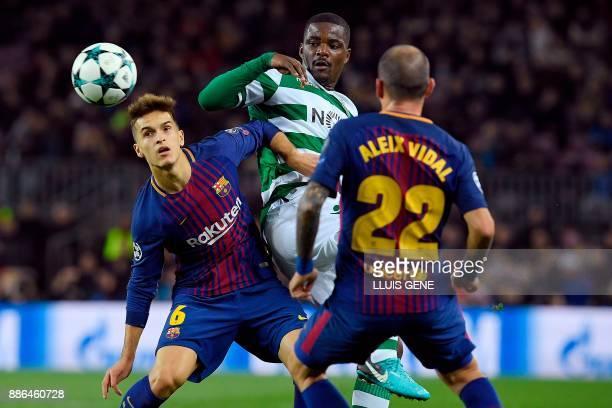 Sporting's Portuguese midfielder William Carvalho challenges Barcelona's Spanish midfielder Denis Suarez and Barcelona's Spanish midfielder Aleix...