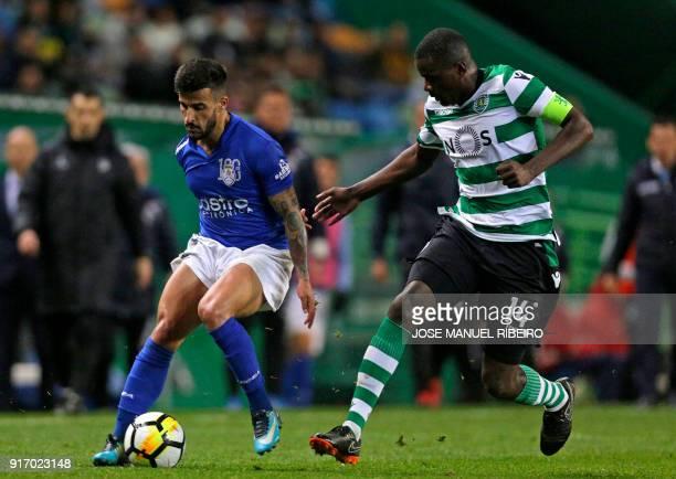 Sportings Portuguese midfielder William Carvalho vies with Feirenses Portuguese midfielder Tiago Silva during the Portuguese league football match...